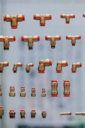 New valves for flow control of cold and hot water on exhibition wall  Stock Photo