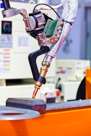 Robotic cutting machinel for industrial manufacture factory; note shallow depth of field