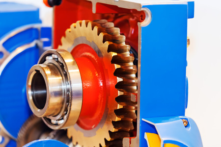 Gearbox on large electric motor at industrial equipment plant 版權商用圖片