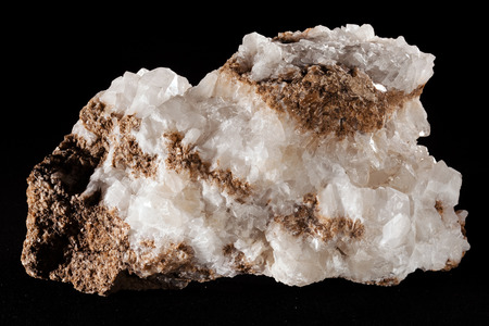 colemanite mineral on the black background