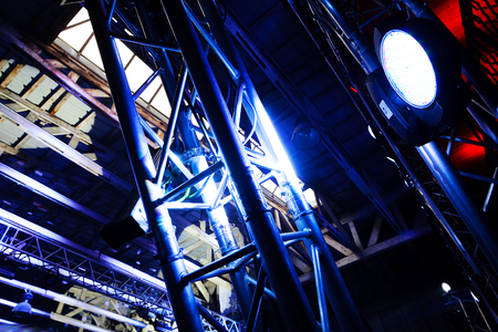 Big white spotlight on a outdoor concert lighting rig Stock Photo