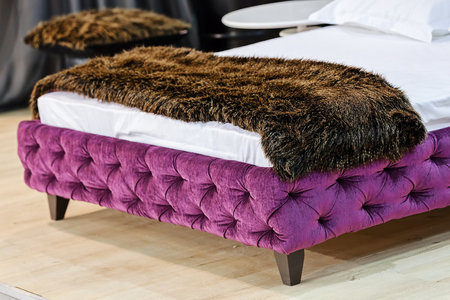 exhibit a double bed at the furniture  fair , note shallow depth of field