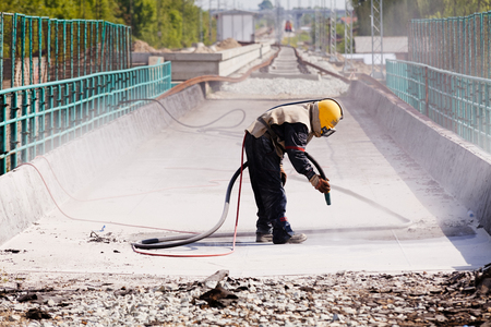 blasting of concrete, note shallow depth of field
