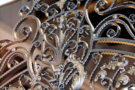 blacksmith: Details, structure and ornaments of wrought iron fence with gate