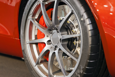 Modern steel car wheel with new tyre