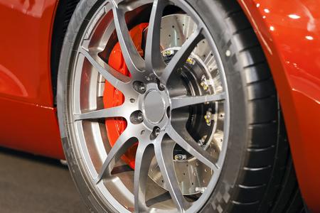Modern steel car wheel with new tyre