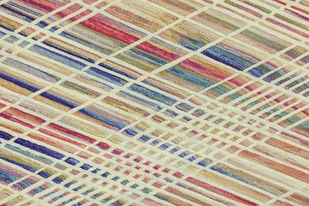 voorbeeld kleurrijk tapijt voor de kamer, let op ondiepe scherptediepte