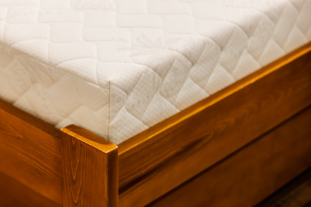 part of double bed  on the fair , note shallow depth of field