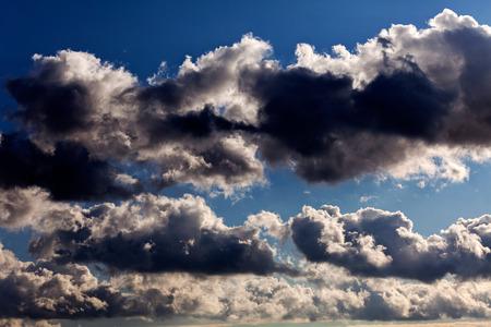 Dark storm clouds on blue sky before rain