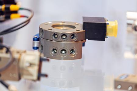 Een detail en onderdeel van een nieuwe machine; let op ondiepe scherptediepte