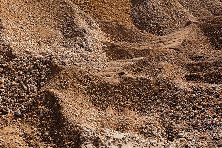 zand- en grindstapels in de bouw