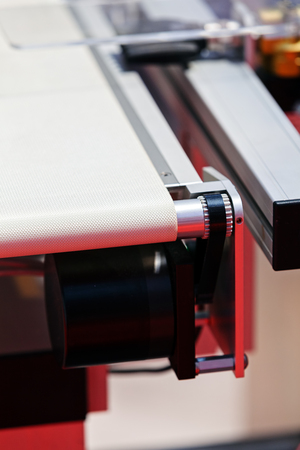 Closeup conveyor belt on the machine with protection; note shallow depth of field Stock fotó