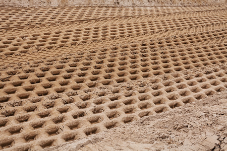 smaller sand with tire tracks in construction Stock fotó