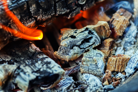 fireplace: Wood burning with flames, ash and smoke in a barbecue Stock Photo