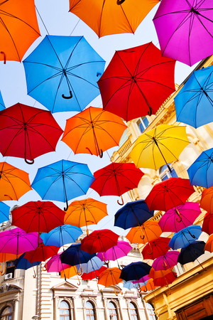 Street decorated with opened hanging colorful umbrellas Stock Photo