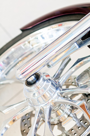The front tire of a parked motorcycle Imagens