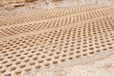 kleinere zand met bandsporen in de bouw