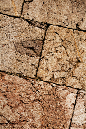 An old brown colors stone wall background. Stok Fotoğraf - 89248505