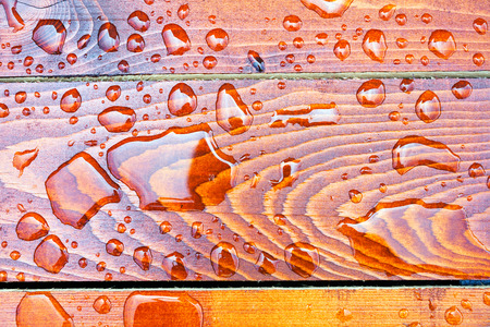 Water drops on a wooden background Stock Photo