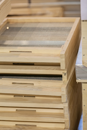 combination: wooden moldings for frames for honeycombs, note shallow depth of field