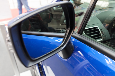 rearview: side mirror on the motor vehicle, note shallow depth of field Stock Photo