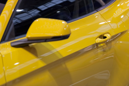 rearview mirror on the motor vehicle, note shallow depth of field Banco de Imagens - 87296069