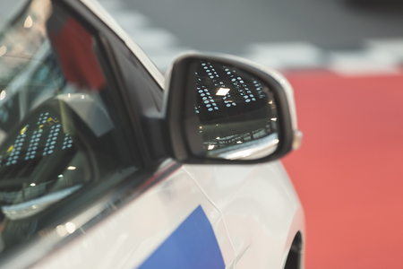 rearview: rearview mirror on the motor vehicle, note shallow depth of field