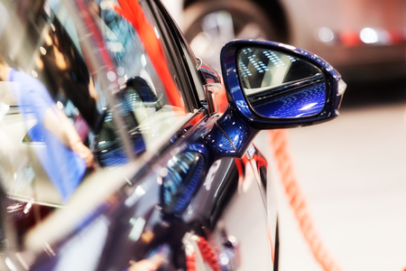 rearview mirror on the motor vehicle, note shallow depth of field