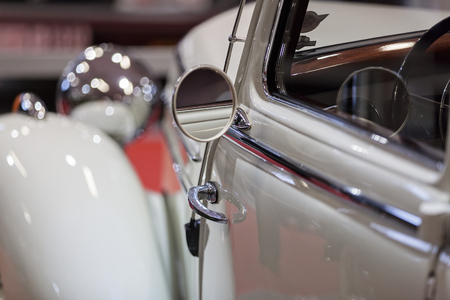 mirror the old-timer in the exhibition, note shallow depth of field Banco de Imagens