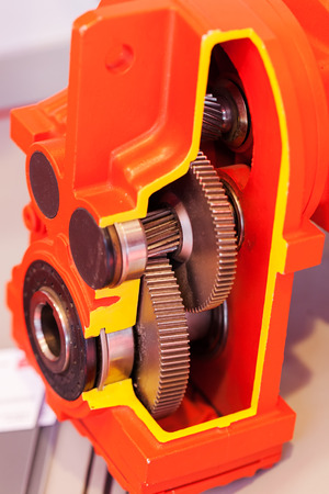 section of vertical gear unit with cylindrical gears, note shallow depth of field Stock Photo