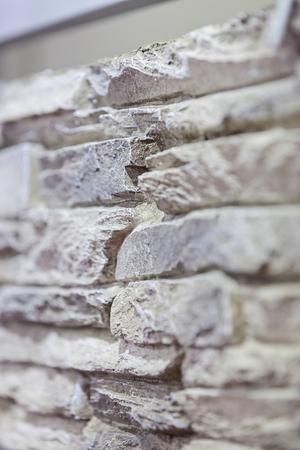 새로운 돌 벽의 일부 참고 얕은 피사계 심도