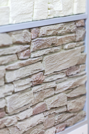 a part of new stone wall, note shallow depth of field Stock Photo