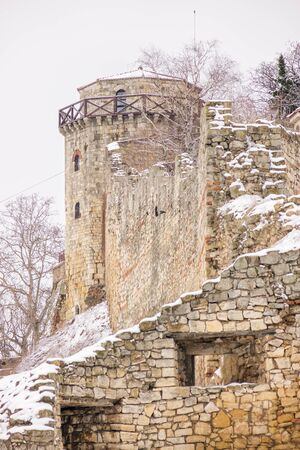 Look at the various parts of the Belgrade fortress under the snow, note shallow depth of field
