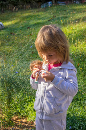 child in nature in early autumn
