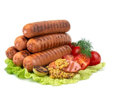 delicious grilled sausages,cherry tomatoes,dill, fried garlic, mustard sauce on a lettuce leaf, close-up, isolated white background Stock Photo