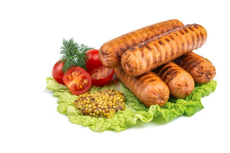 delicious grilled sausages, cherry tomatoes, dill, fried garlic, mustard sauce on a lettuce leaf, close-up, isolated white background, horizontal view