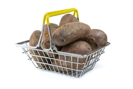 Raw pink potato tubers in a shopping basket on a white isolated background.Potatoes in the skin. Reklamní fotografie