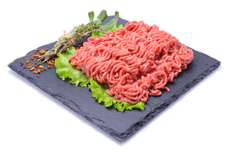 Fresh minced pork and beef and spices on a slate stone.Isolated on a white background, selective focus. horizontal view Stock Photo