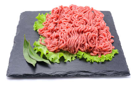Fresh minced pork and beef and spices on a slate stone.Isolated on a white background, selective focus. horizontal view