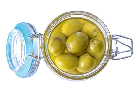 green pickled olives in a glass jar, isolated on a white background Imagens