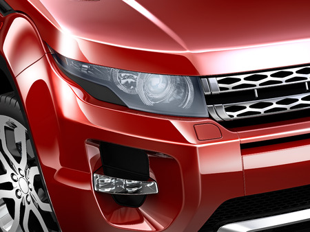 headlamp: Headlamp detail of compact red SUV