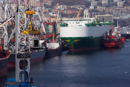 impressive: Several ships unloading by cranes with a panorama of the city in the background