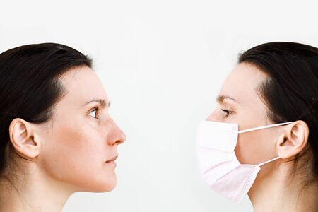 woman profiles with and without medical mask showing before and after and duality concept Stock Photo