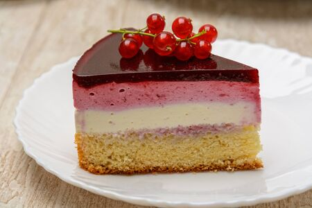 A slice of delicious berry cake on the plate.