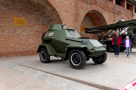 armored car: Tourists visiting the armored car BA-64 at exhibition of military equipment of times of World War II in the Kremlin of Nizhny Novgorod.
