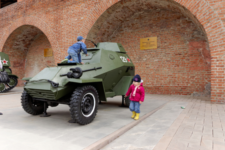 armored car: Children playing on the armored car BA-64 at exhibition of military equipment of times of World War II in the Kremlin of Nizhny Novgorod.