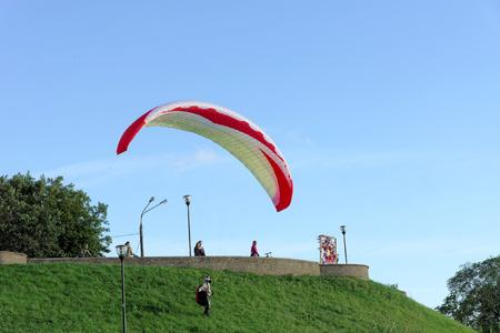 high flier: Nizhny Novgorod, Russia - June 26.2014. Starting paragliding from the high bank of the Volga River in Nizhny Novgorod.