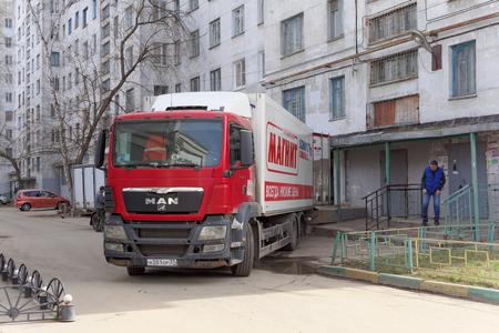 drove: Nizhny Novgorod, Russia. - April 14.2016. Cargo fura drove backwards to the rear entrance of the store MAGNET unloading goods. Street Sovnarkomovskaya 26.