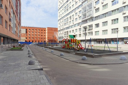 fenced: Nizhny Novgorod, Russia. - April 26.2016. Outfitted fenced yard area with a childrens playground on the street Nevzorov 64 Editorial