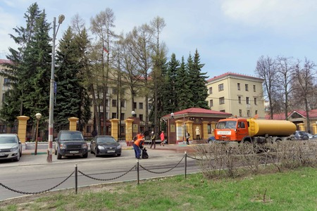 prosecutor: Nizhny Novgorod, Russia. - April 26.2016. Janitors clean the garbage the street in front of the prosecutors office of the Nizhny Novgorod region. Editorial